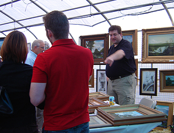 Ives Farm - John O'Keefe working his booth and talking with art patrons