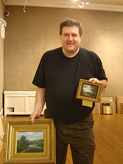 John O'Keefe with paintings New England River and The Road Home
