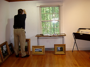 Mill House Gallery Exhibit paintings are hung prior to exhibit