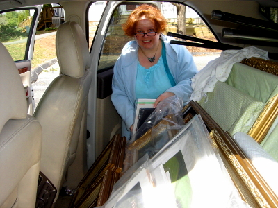 Mill House Gallery Exhibit paintings are carefully packed into car