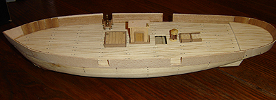 John O'Keefe's partial wooden model of a sail powered ship (view 2), started when he was eleven years old