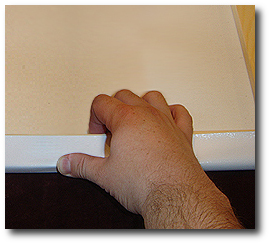 16 x 20 Canvas Stretching - Step 27 - Firmly hold canvas in position with thumb
