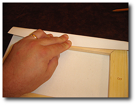 8 x 10 Canvas Stretching - Step 18 - Fold canvas print over first stretcher bar
