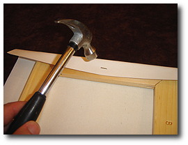 8 x 10 Canvas Stretching - Step 21 - Seat staple with hammer if not fully inserted